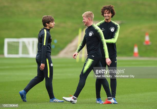 Manchester City's Kevin de Bruyne with Philippe Sandler and Adrian Bernabe during the training session at Manchester City Football Academy on October...