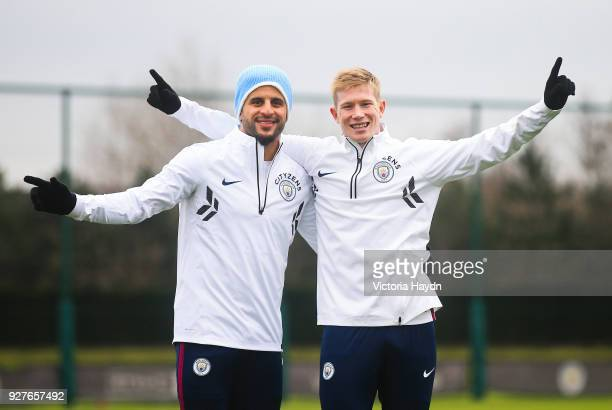 Manchester City's Kyle Walker and Kevin de Bruyne pose during the training session at Manchester City Football Academy on March 5 2018 in Manchester...