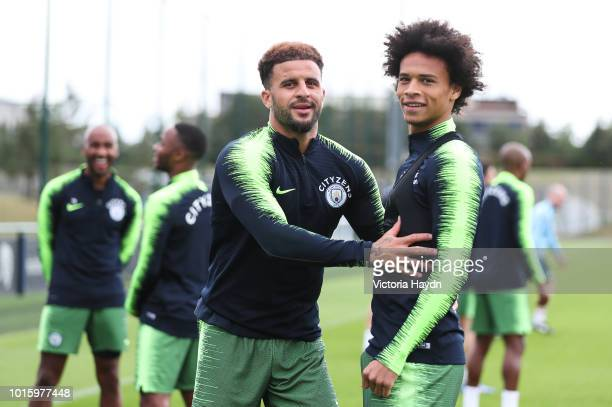 Manchester City's Kyle Walker and Leroy Sane during training at Manchester City Football Academy on August 10 2018 in Manchester England