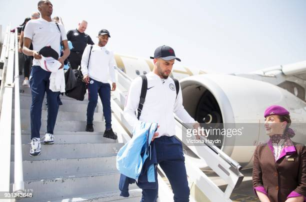 Manchester City's Kyle Walker and teammates arrive at Abu Dhabi International Airport on March 13 2018 in Abu Dhabi UAE