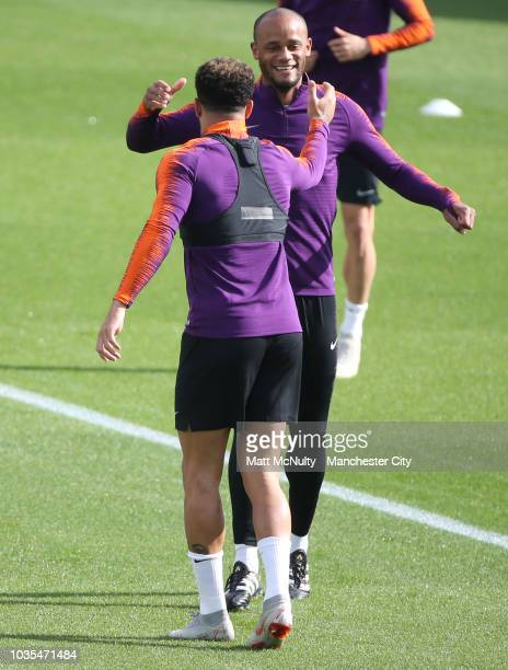 Manchester City's Kyle Walker and Vincent Kompany durining training at Manchester City Football Academy on September 18 2018 in Manchester England