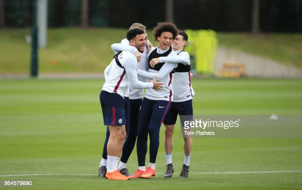 Manchester City's Kyle Walker Kevin De Bruyne John Stones Phil Foden and Leroy Sane in training at Manchester City Football Academy on May 4 2018 in...
