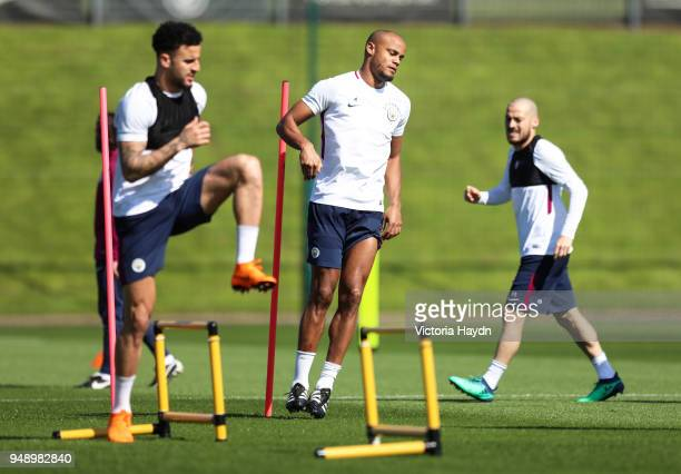 Manchester City's Kyle Walker Vincent Kompany and David Silva during the training session at Manchester City Football Academy on April 19 2018 in...