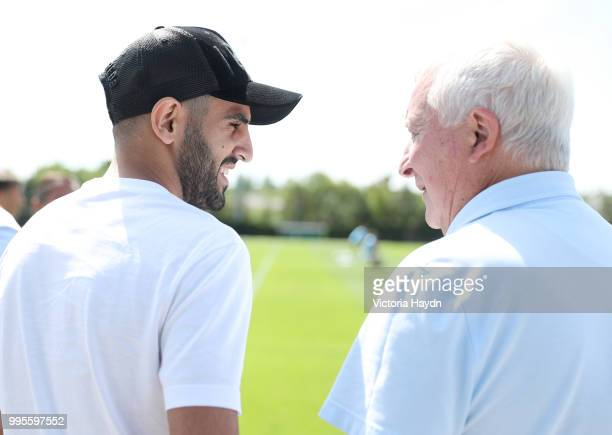 Manchester City's legend Mike Summervee welcomes new signing Riyad Mahrez on his first day at Manchester City Football Academy on July 10 2018 in...