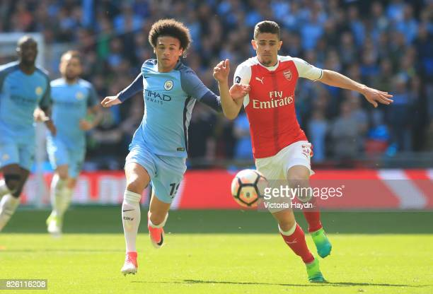 Manchester City's Leroy Sane and Arsenal's Gabriel Paulista battle for the ball
