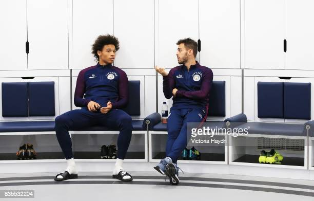 Manchester City's Leroy Sane and Bernardo Silva talk in the dressing room during their first visit to the new facilities at Etihad Stadium on August...