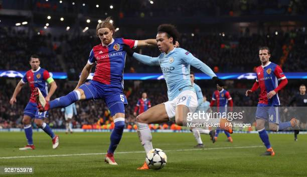 Manchester City's Leroy Sane and FC Basel's Michael Lang battle for the ball during the UEFA Champions League round of 16 second leg match at the...