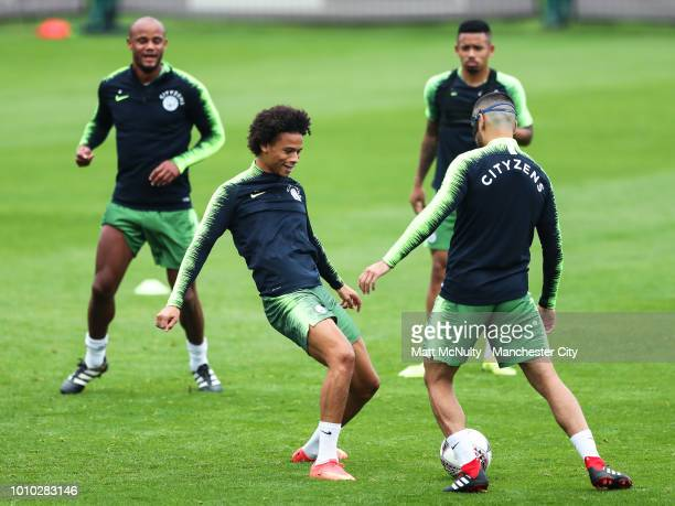 Manchester City's Leroy Sane and Ilkay Gundogan during training at Manchester City Football Academy on August 3 2018 in Manchester England