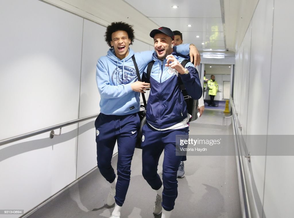 Manchester City's Leroy Sane and Kyle Walker board the flight at Manchester Airport on March 13, 2018 in Manchester, England.