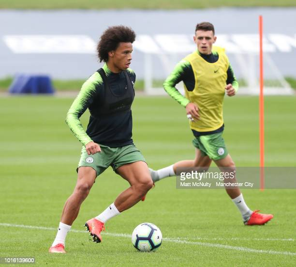 Manchester City's Leroy Sane and Phil Foden during training at Manchester City Football Academy on August 13 2018 in Manchester England
