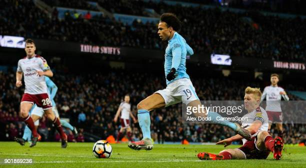 Manchester City's Leroy Sane beats Burnley's Ben Mee before slotting his side's third goal during the Emirates FA Cup Third Round match between...