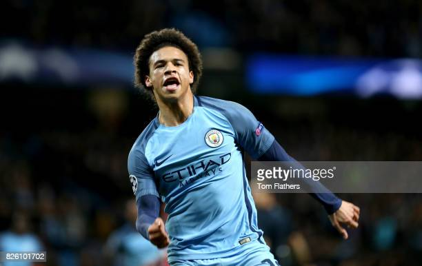 Manchester City's Leroy Sane celebrates after teammate Manchester City's Raheem Sterling scores his side's first goal of the game