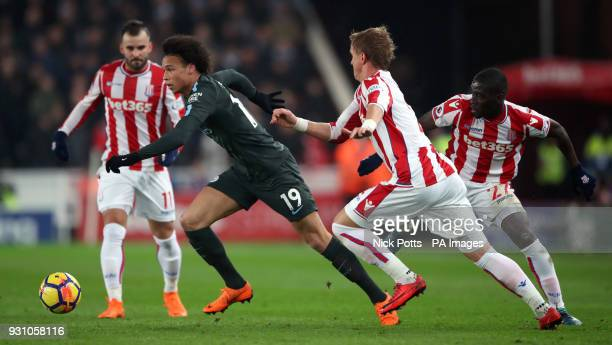 Manchester City's Leroy Sane gets away from the Stoke City defence during the Premier League match at the bet365 Stadium Stoke