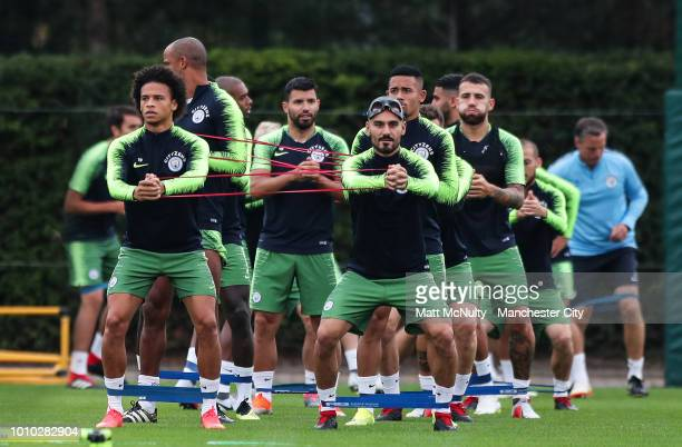 Manchester City's Leroy Sane Ilkay Gundogan and teammates during training at Manchester City Football Academy on August 3 2018 in Manchester England