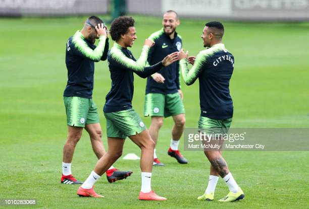 Manchester City's Leroy Sane jokes with teammates during training at Manchester City Football Academy on August 3 2018 in Manchester England