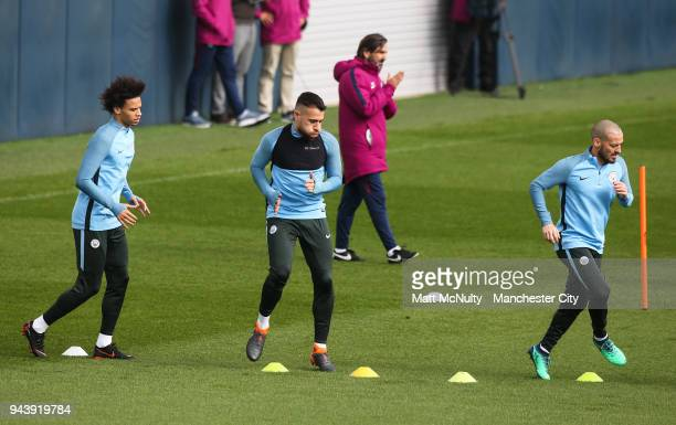 Manchester City's Leroy Sane Nicolas Otamendi and David Silva during training at Manchester City Football Academy on April 9 2018 in Manchester...