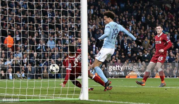 Manchester City's Leroy Sane scores despite the attentions of Liverpool's Alex OxladeChamberlain but his effort is disallowed by the offside rule...