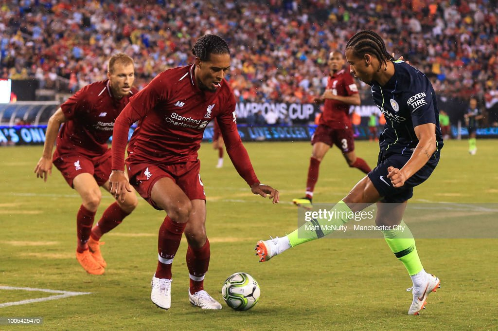 Manchester City's Leroy Sane takes on Liverpool's Virgil van Dijk during the International Champions Cup match between Manchester City and Liverpool at the MetLife Stadium on July 25, 2018 in East Rutherford, New Jersey.