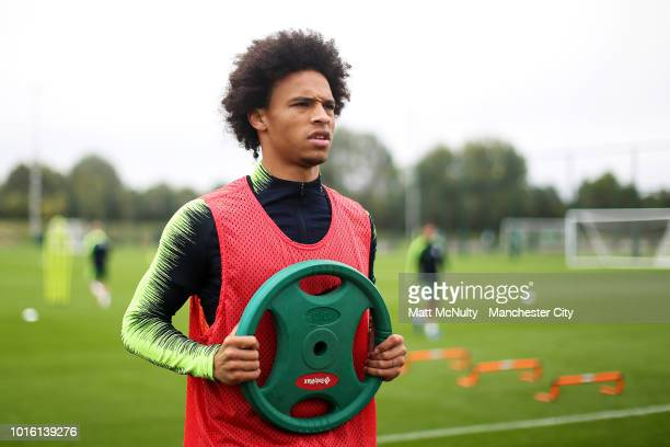 Manchester City's Leroy Sane uses weights during training at Manchester City Football Academy on August 13 2018 in Manchester England