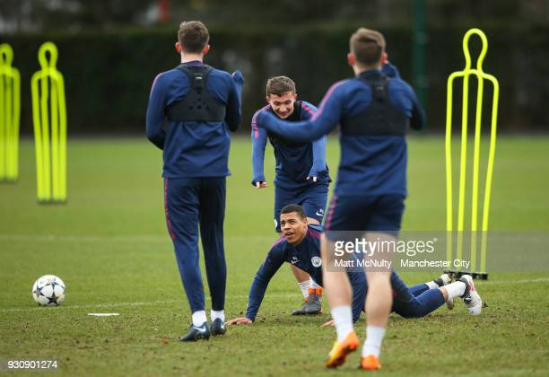Manchester City's Lukas Nmecha Tyreke Wilson and teammates react during training at Manchester City Football Academy on March 12 2018 in Manchester...