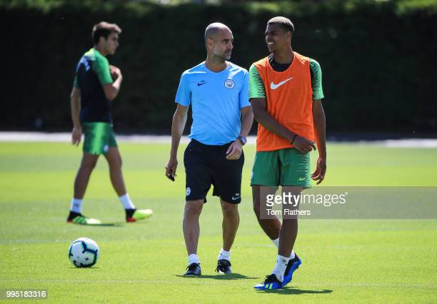 Manchester City's Lukas Nmecha with manager Pep Guardiola during training at Manchester City Football Academy on July 10 2018 in Manchester England