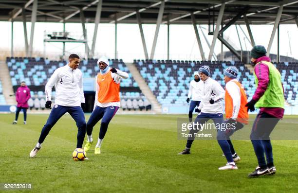 Manchester City's Lukas Nmecha Yaya Toure and teammates during training at Manchester City Football Academy on March 2 2018 in Manchester England