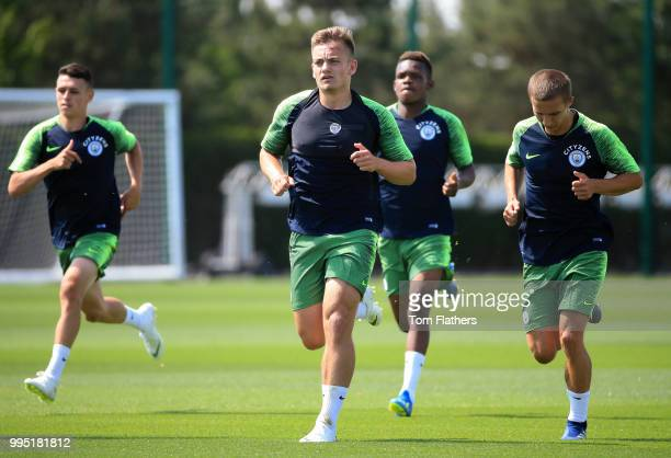 Manchester City's Luke Bolton and teammates during training at Manchester City Football Academy on July 10 2018 in Manchester England