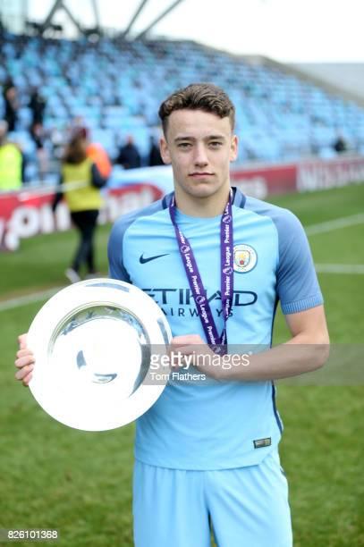 Manchester City's Luke Bolton celebrates winning the U18 Northern Premier League trophy