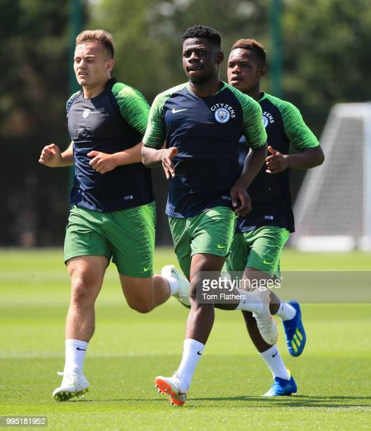 Manchester City's Luke Bolton Rabbi Matondo and Tom DeleBashiru during training at Manchester City Football Academy on July 10 2018 in Manchester...