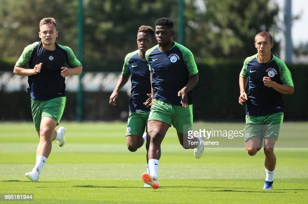 Manchester City's Luke Bolton Rabbi Matondo Tom DeleBashiru and Tyreke Wilson during training at Manchester City Football Academy on July 10 2018 in...