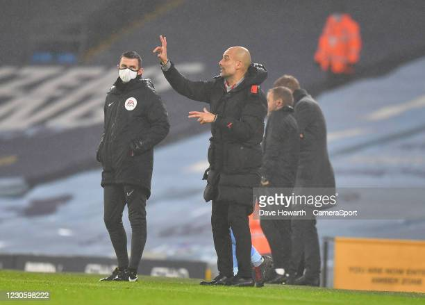 Manchester City's Manager Josep Guardiola Shouts to his team during the game during the Premier League match between Manchester City and Brighton &...