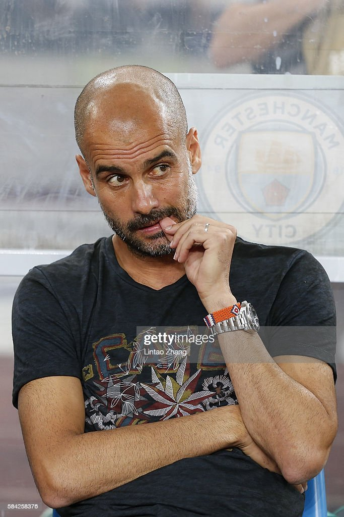 Manchester City's manager Pep Guardiola looks on during the 2016 International Champions Cup match between Manchester City and Borussia Dortmund at Shenzhen Universiade Stadium on July 28, 2016 in Shenzhen, China.