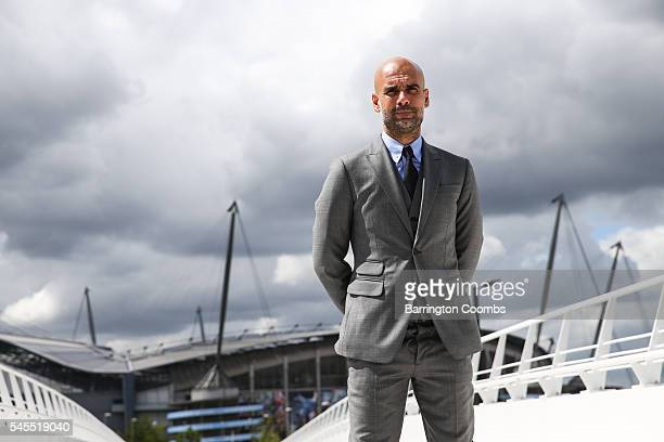 Manchester City's manager Pep Guardiola poses for photographs outside the Etihad Stadium on July 8 2016 in Manchester England