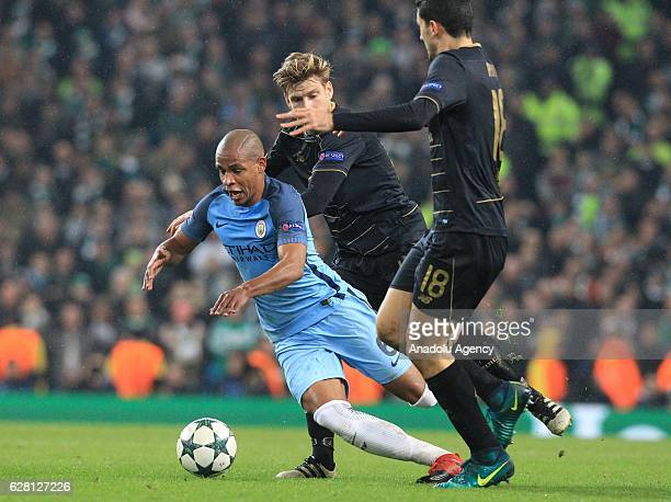 Manchester City's midfielder Fernando Reges is fouled by Celtic's midfielder Stuart Armstrong during the Champions League Group C stage soccer match...