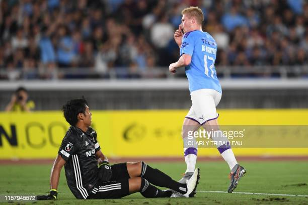 Manchester City's midfielder Kevin De Bruyne celebrates after scoring during a friendly football match between English Premier League club Manchester...