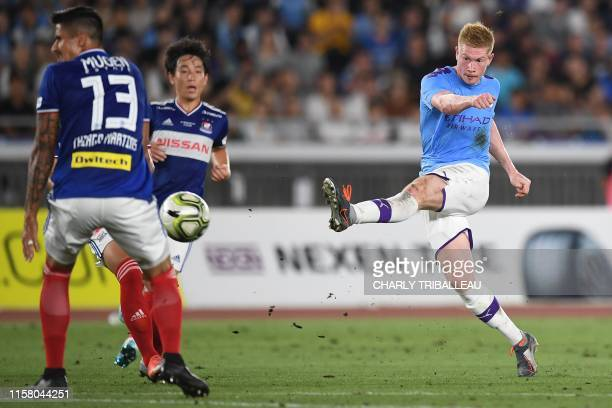 Manchester City's midfielder Kevin De Bruyne shoots the ball during a friendly football match between English Premier League club Manchester City and...
