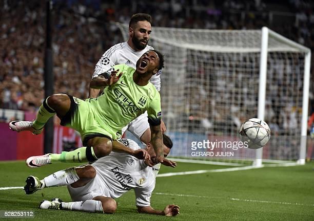 Manchester City's midfielder Raheem Sterling vies with Real Madrid's defender Dani Carvajal and Real Madrid's midfielder Lucas Vazquez during the...