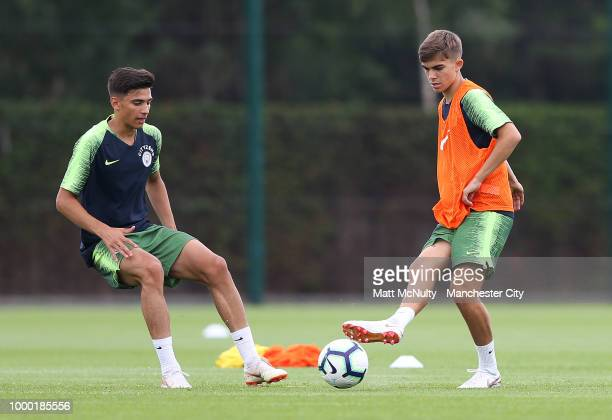 Manchester City's Nabil Touaizi and Iker Pozo during training at Manchester City Football Academy on July 16 2018 in Manchester England