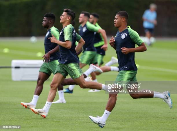 Manchester City's Nabil Touaizi and teammates during training at Manchester City Football Academy on July 16 2018 in Manchester England