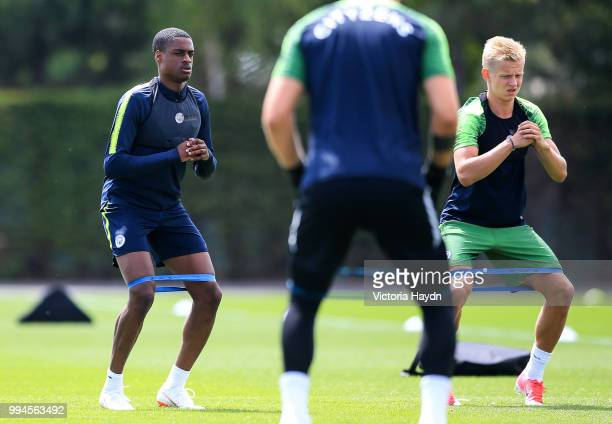 Manchester City's Nathaniel Ogbeta and Oleksandr Zinchenko during training at Manchester City Football Academy on July 6 2018 in Manchester England