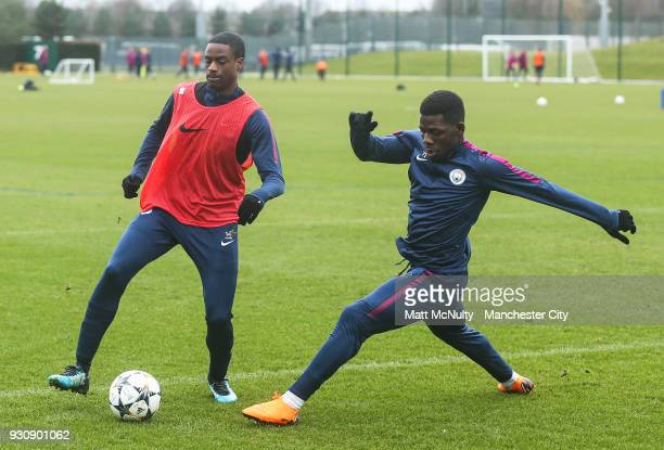 Manchester City's Nathaniel Ogbeta and Tom DeleBashiru during training at Manchester City Football Academy on March 12 2018 in Manchester England