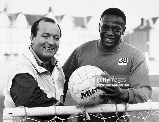 'Manchester City's new boy Justin Fashanu with his manager Mel Machin posing at the training ground'