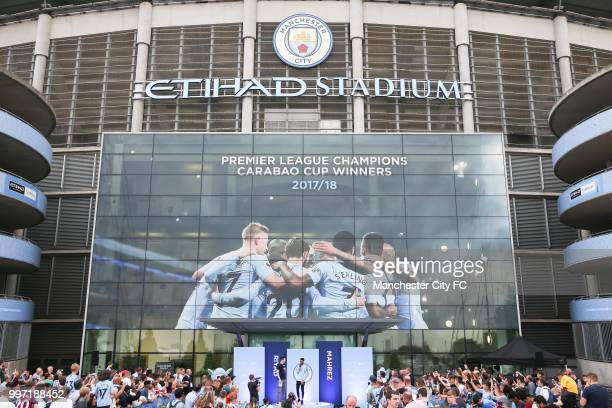 Manchester City's new club record signing Riyad Mahrez is revealed to fans outside Manchester City Football Stadium's West Reception on July 12 2018...