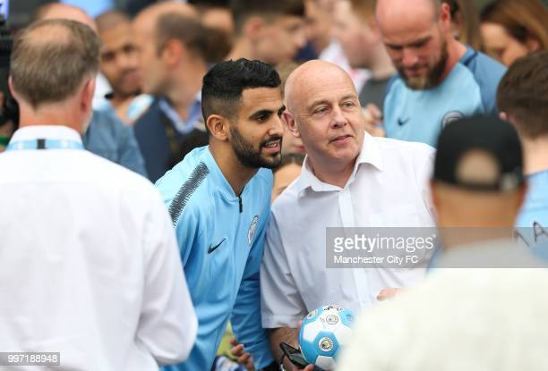 Manchester City's new club record signing Riyad Mahrez takes pictures with fans outside Manchester City Football Stadium's West Reception on July 12...
