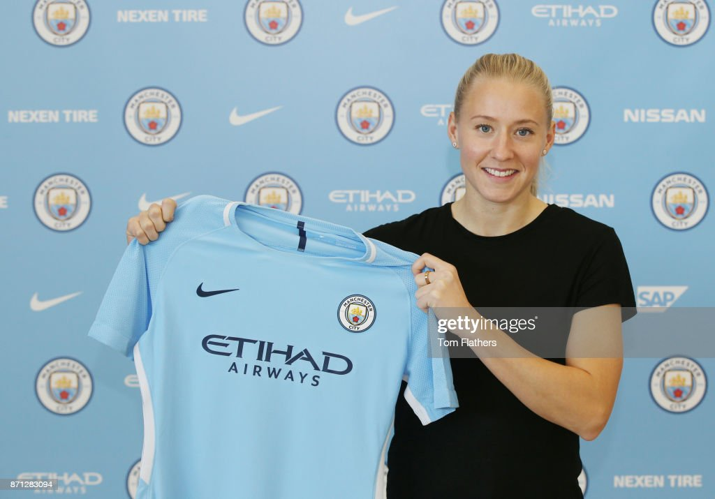Manchester City's new signing Julia Spetsmark poses with a shirt at the Manchester City Football Academy on November 6, 2017 in Manchester, England.