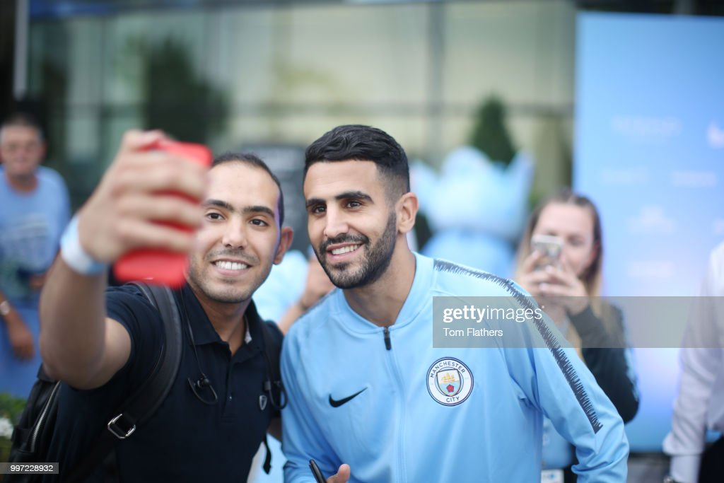 Manchester City's new signing Riyad Mahrez is revealed to fans outside Manchester City Football Stadium's West Reception on July 12, 2018 in Manchester, England.