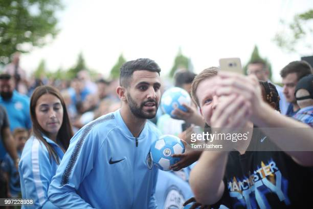 Manchester City's new signing Riyad Mahrez is revealed to fans outside Manchester City Football Stadium's West Reception on July 12 2018 in...