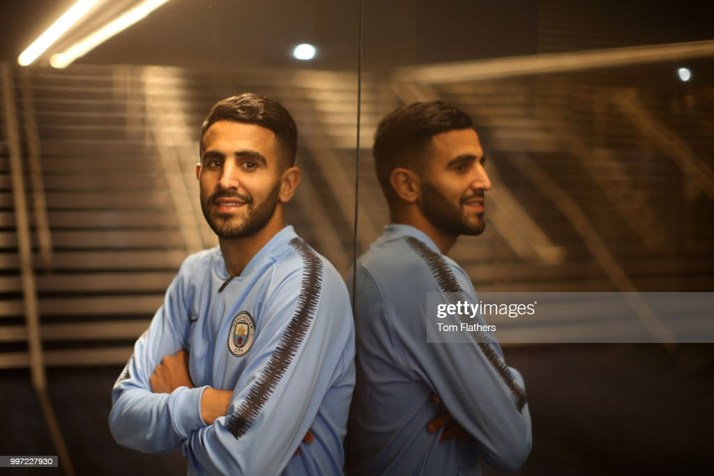 Manchester City's new signing Riyad Mahrez poses for a portrait at the Etihad Stadium on July 12, 2018 in Manchester, England.