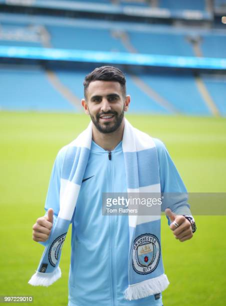 Manchester City's new signing Riyad Mahrez wearing a scarf at the Etihad Stadium on July 12 2018 in Manchester England