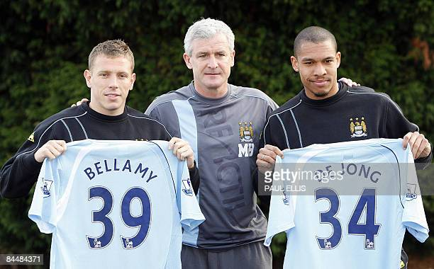 Manchester City's new signings Welsh striker Craig Bellamy and Dutch midfielder Nigel De Jong pose for photographers with Manchester City manager...